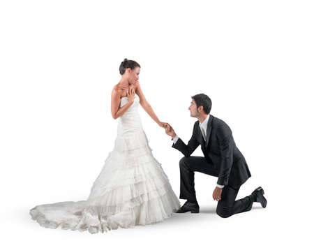 proposal: Husband kneels for a romantic marriage proposal