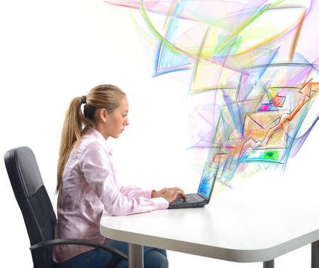 Businesswoman send work email from her office Standard-Bild