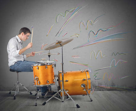 A drummer plays his instrument producing notes