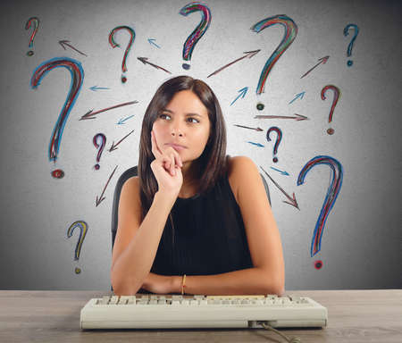 question marks: A businesswoman thinks and does the questions
