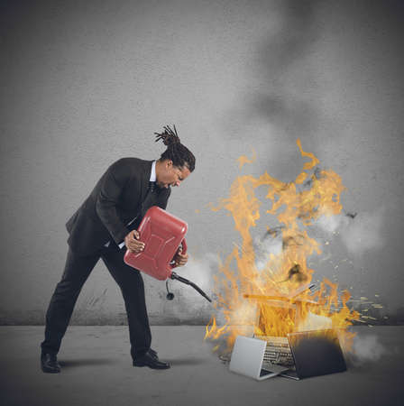 A businessman stressed and pissed burns computers