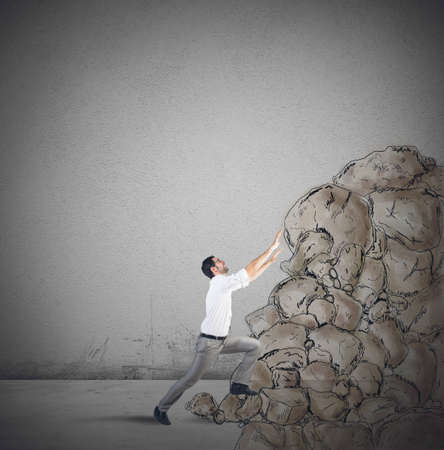 ponderous: Tired businessman struggling to climb the success Stock Photo