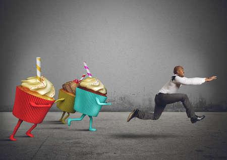 man eating: Man runs away from sweets and calories
