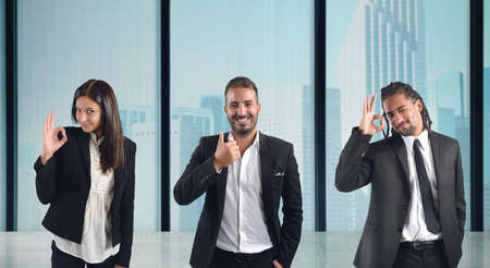 come in: Businesspeople come to agreement in the office