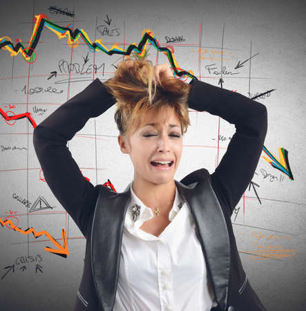 collapse: Exhausted businesswoman despairs for the financial collapse