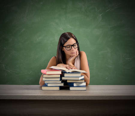 reads: A young teacher concentrated reading a book Stock Photo