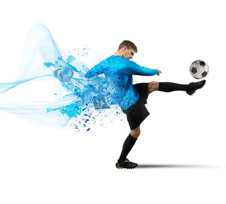 Soccer player kicks a ball with force
