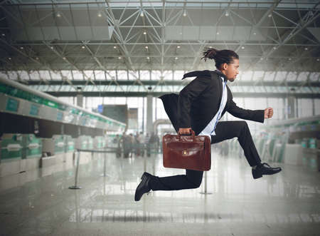 Businessman runs in the airport because late