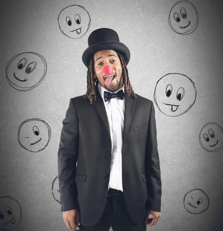 Man grimacing with hat and clown nose