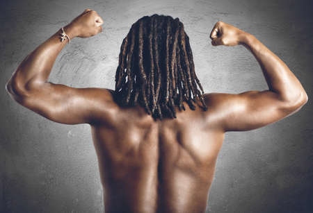 tricep: Man shows his back and muscular