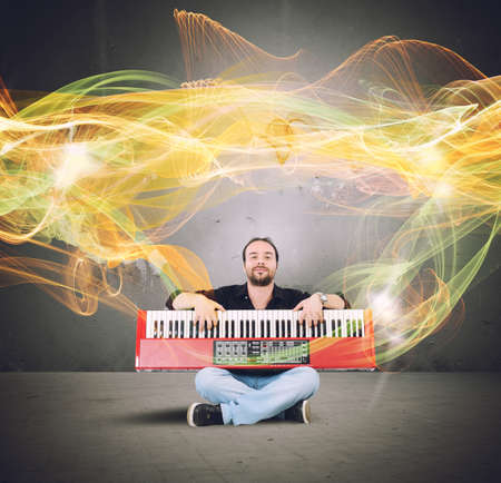 pianoforte: Artist plays the piano with golden waves Stock Photo