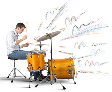 producing: A drummer plays his instrument producing notes Stock Photo