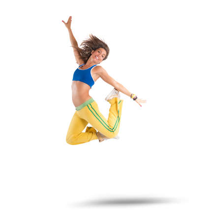A dancer jumps in a zumba choreography Stockfoto