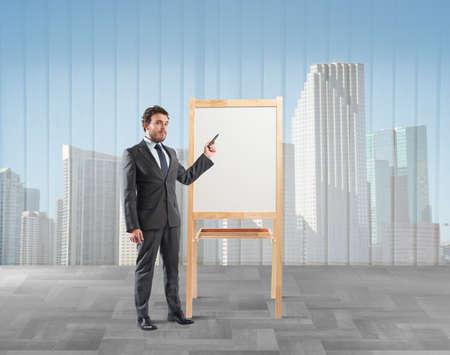 explains: Businessman shows and explains his working plan Stock Photo
