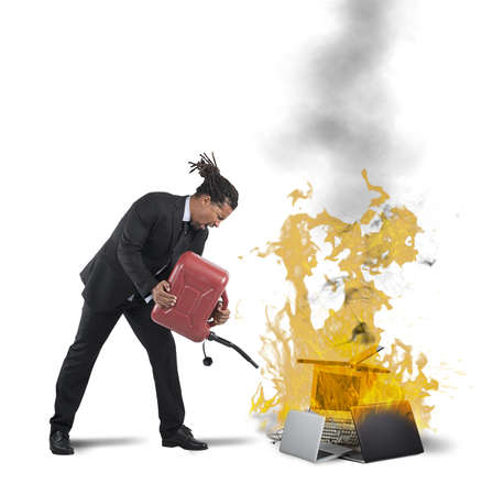 destroying: A businessman stressed and pissed burns computers