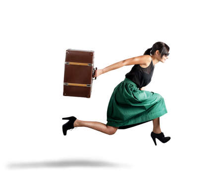 Elegant beautiful woman tourist runs with suitcase