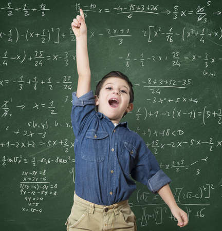 solves: Genius child solves a mathematical calculation difficult Stock Photo