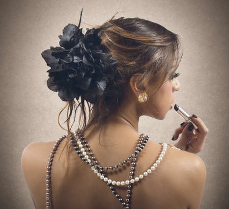 Woman dressed only in strings of pearls