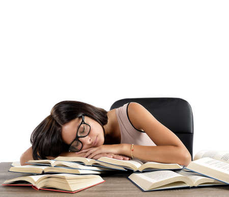 stressful: Woman tired of studying sleeping over books