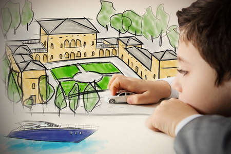 Child plays with his car imagining landscapes Stock Photo