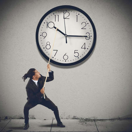 Move clock hands to change the time Stock Photo