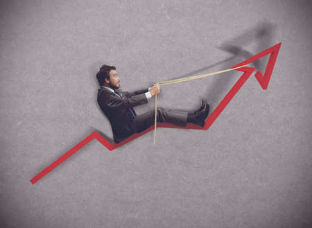 quell: Businessman rides towards the increase of economy Stock Photo