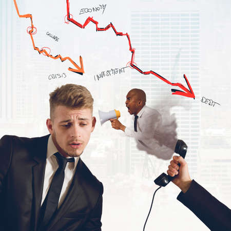 Boss chides his employee of low profits Stock Photo