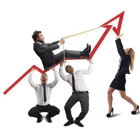 challenging: Business team support the director in his climb Stock Photo