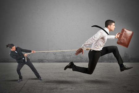 retain: Boss tries to strongly retain his employees Stock Photo