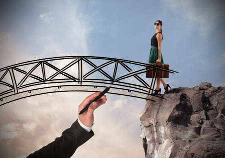 possibility: Woman crosses a bridge with her suitcase Stock Photo
