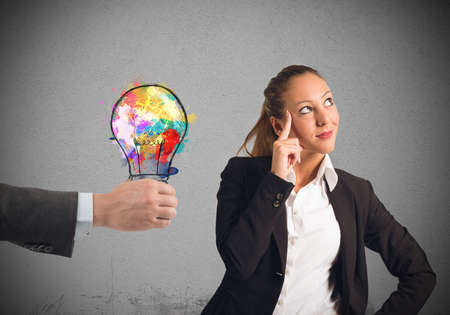 suggests: Colleague suggests an idea to a businesswoman Stock Photo