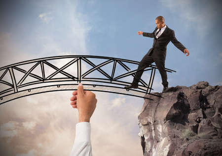difficulties: Help a businessman to overcome an obstacle Stock Photo