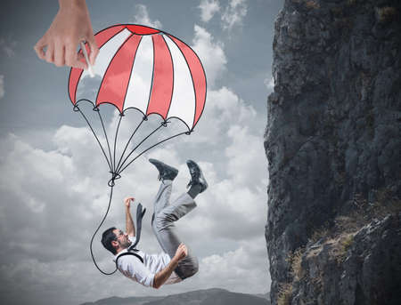 investment risks: Businessman is saved from a fall deep