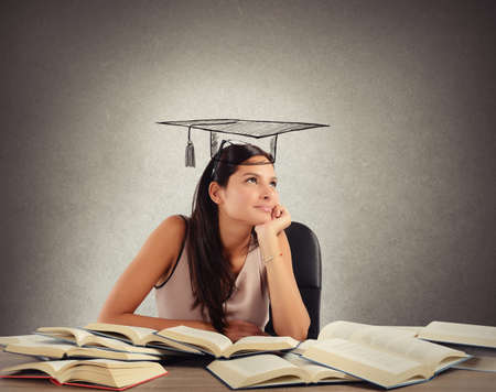 female student: Young student between books dreams the graduation