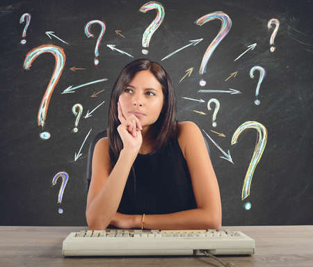 A businesswoman thinks and does the questions