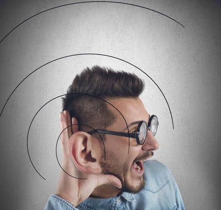 big ear: Man has a great ear to listen better Stock Photo