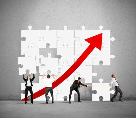 Team werkt samen om de statistieken te verhogen Stockfoto