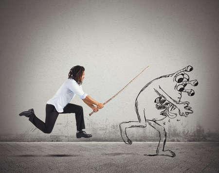 Angry man chasing a bad flu virus Standard-Bild