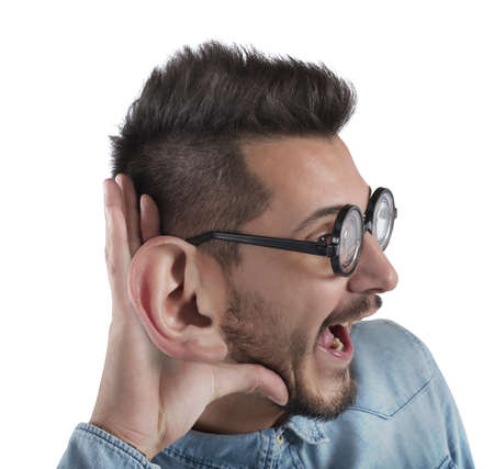 listens: Nerd man listens with curiosity a gossip