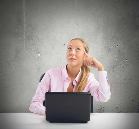intuition: Businesswoman has an intuition working on pc Stock Photo