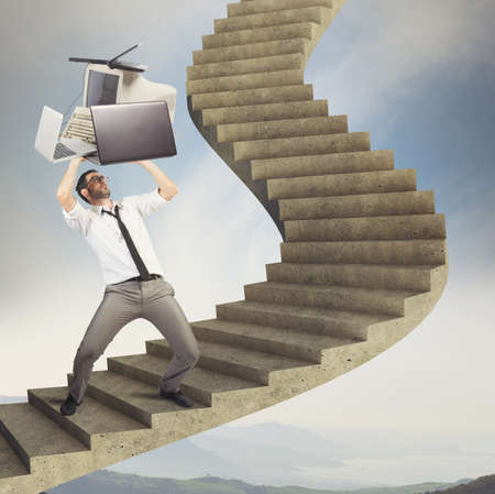 agression: Overload businessman working launches pc from stairs Stock Photo