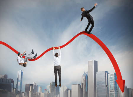 Businessmen falling down toward the economic crisis Stock Photo
