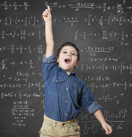 Genius child solves a mathematical calculation difficult Foto de archivo