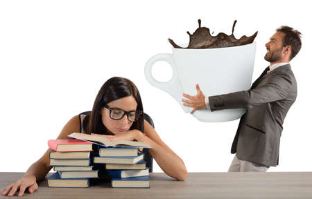 office slave: Tired girl wakes up with much caffeine Stock Photo