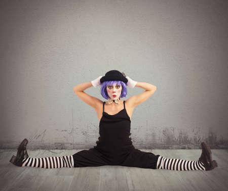 recite: Funny clown dancer makes a big split Stock Photo