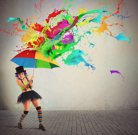Clown is repaired by a colorful rain 스톡 콘텐츠
