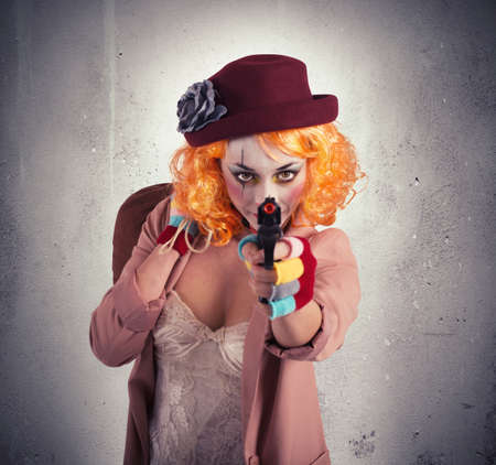 trickster: Thief clown aims to hit with gun