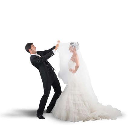 stupor: Amazed husband lifts the veil of wife Stock Photo