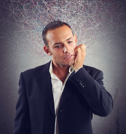 delusion: Businessman stressed and confused about which investment do Stock Photo