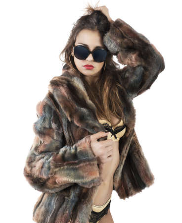 sensuality: Beautiful woman in fur shows her sensuality Stock Photo